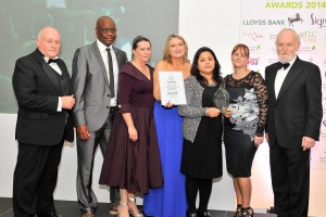 Carebase staff accept an award